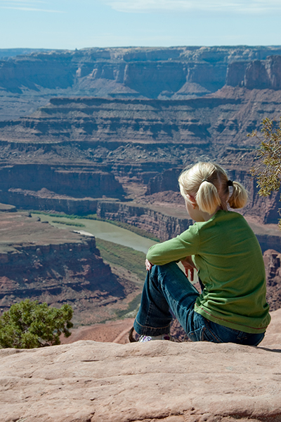 young girl sits at dead horse point small