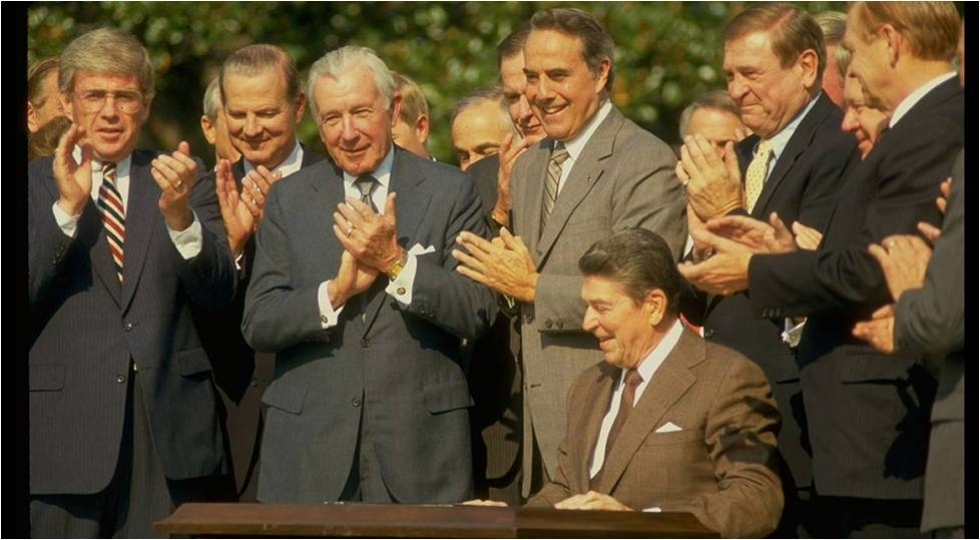 President Reagan signs the 1986 tax reform to bipartisan applause (photo credit Wall Street Journal)